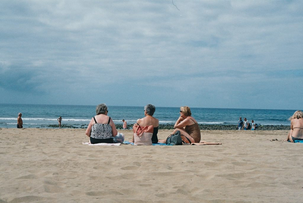 unsplash stock image 3 mature women on a beach