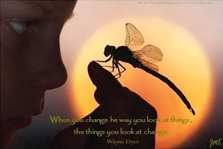 child looking at a dragonfly on his/her finger. Wayne Dyer quote.